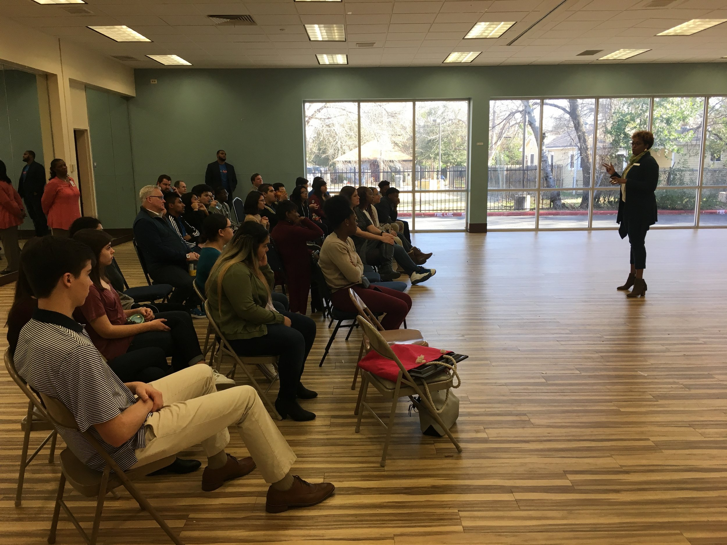 Feb 1, 2018 - MRSC Student Session - Executive Director Ms. Ross speaking to Mayor's Rising Star Council students, Neiman Marcus, DART and Mayor's Star Council representatives about the history of the Queen City neighborhood and the Park South YMCA.