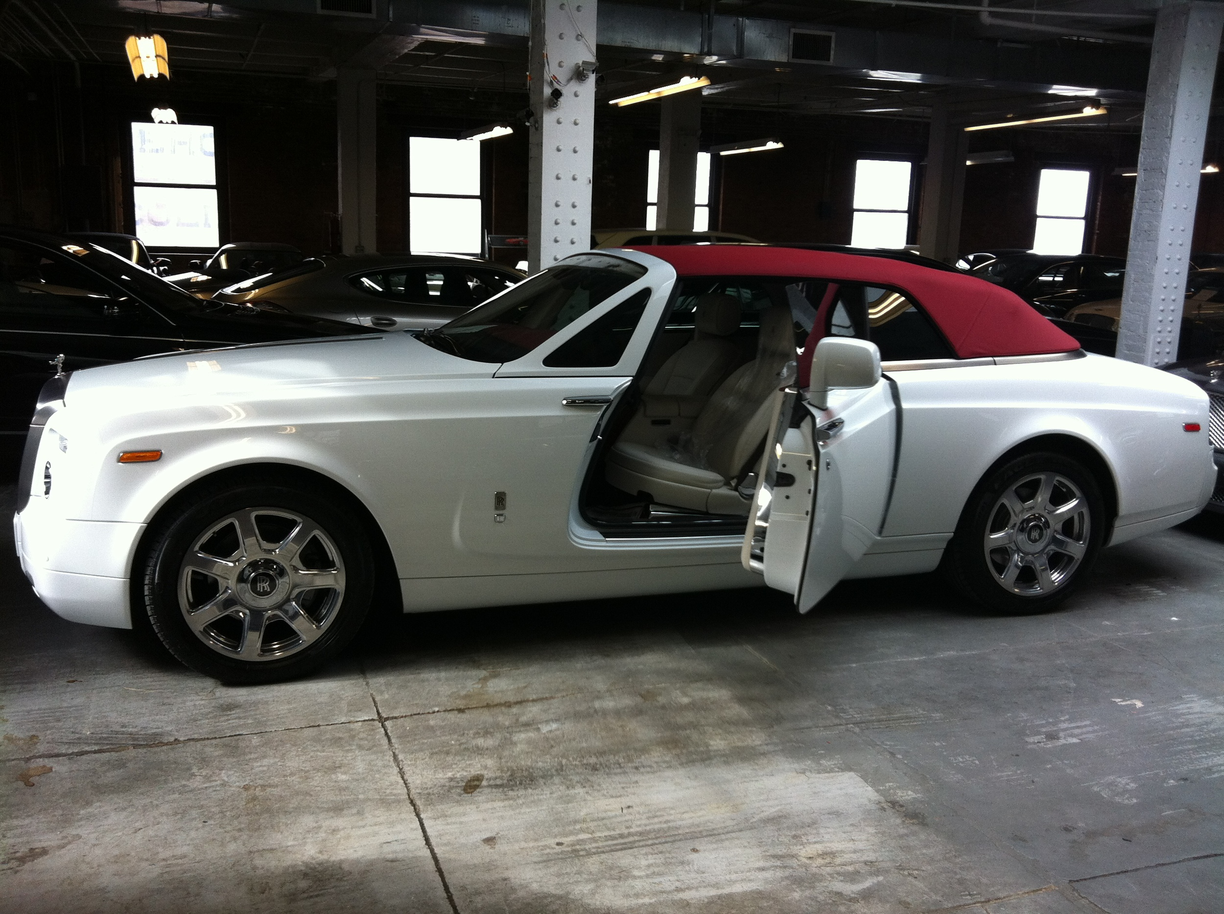 2013 Rolls Royce DropHead Coupe.  This car worth $500k comes with suicide doors that close with a push of a button.