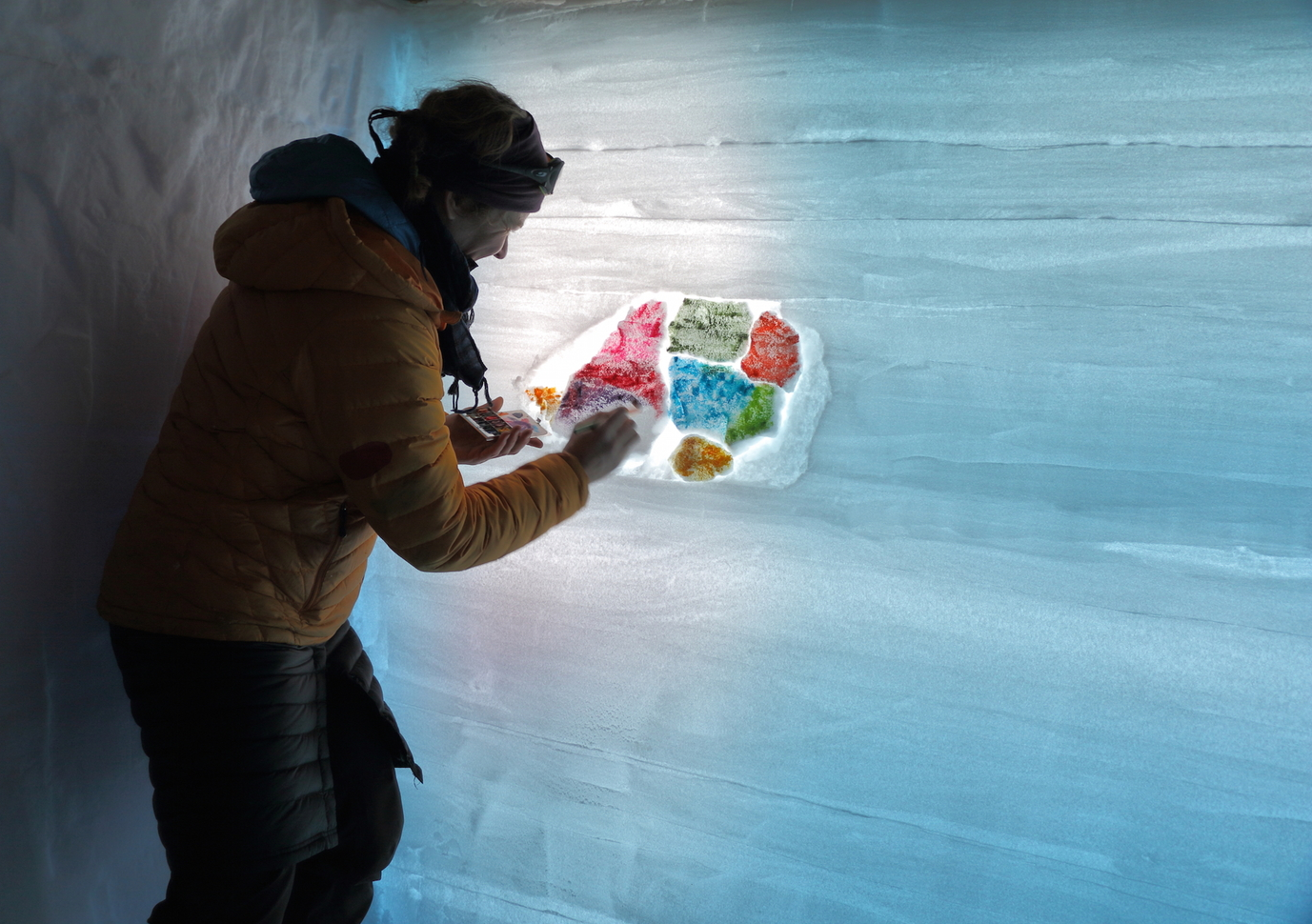 Scientist Erin Pettit expressing her inner artist inside a snowpit at WAIS Divide in January 2015.