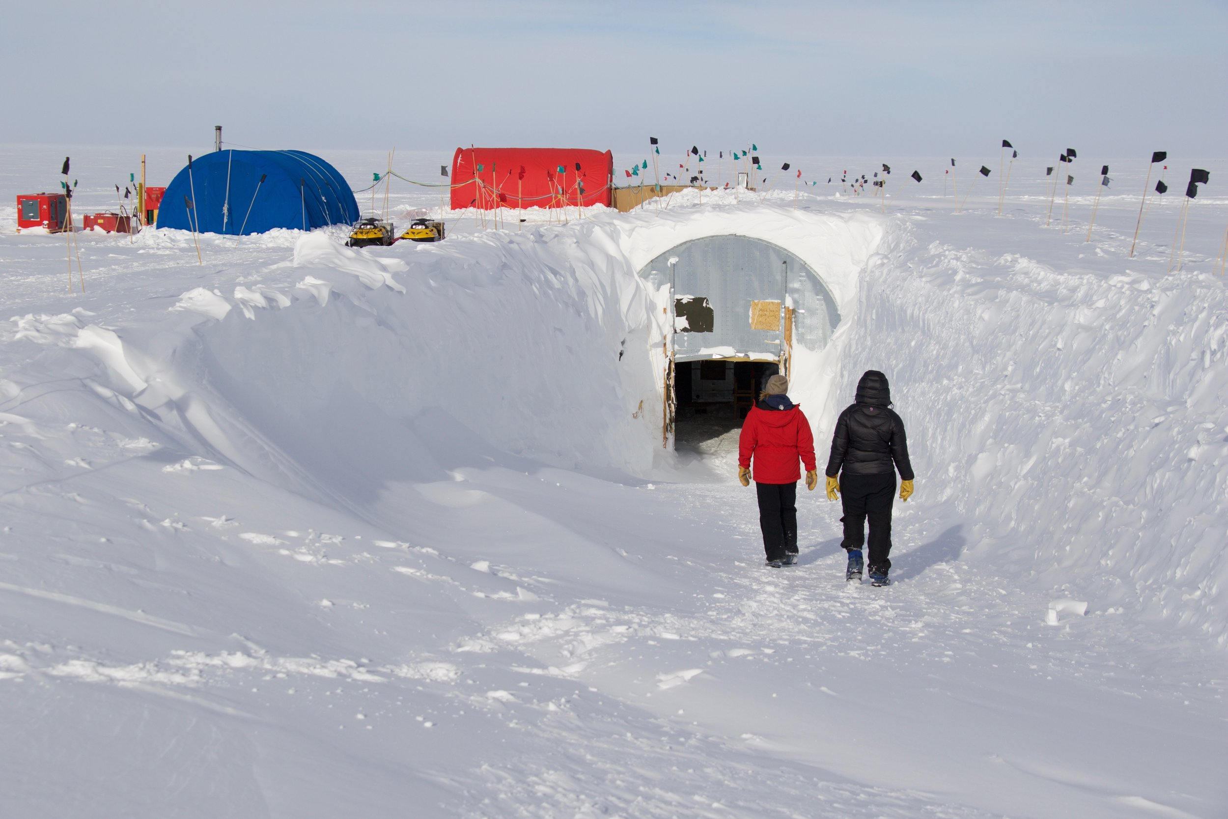 Walking down into the arch, buried in snow. The blue and red tents on the surface are the warming and logging tents we used while collecting data.