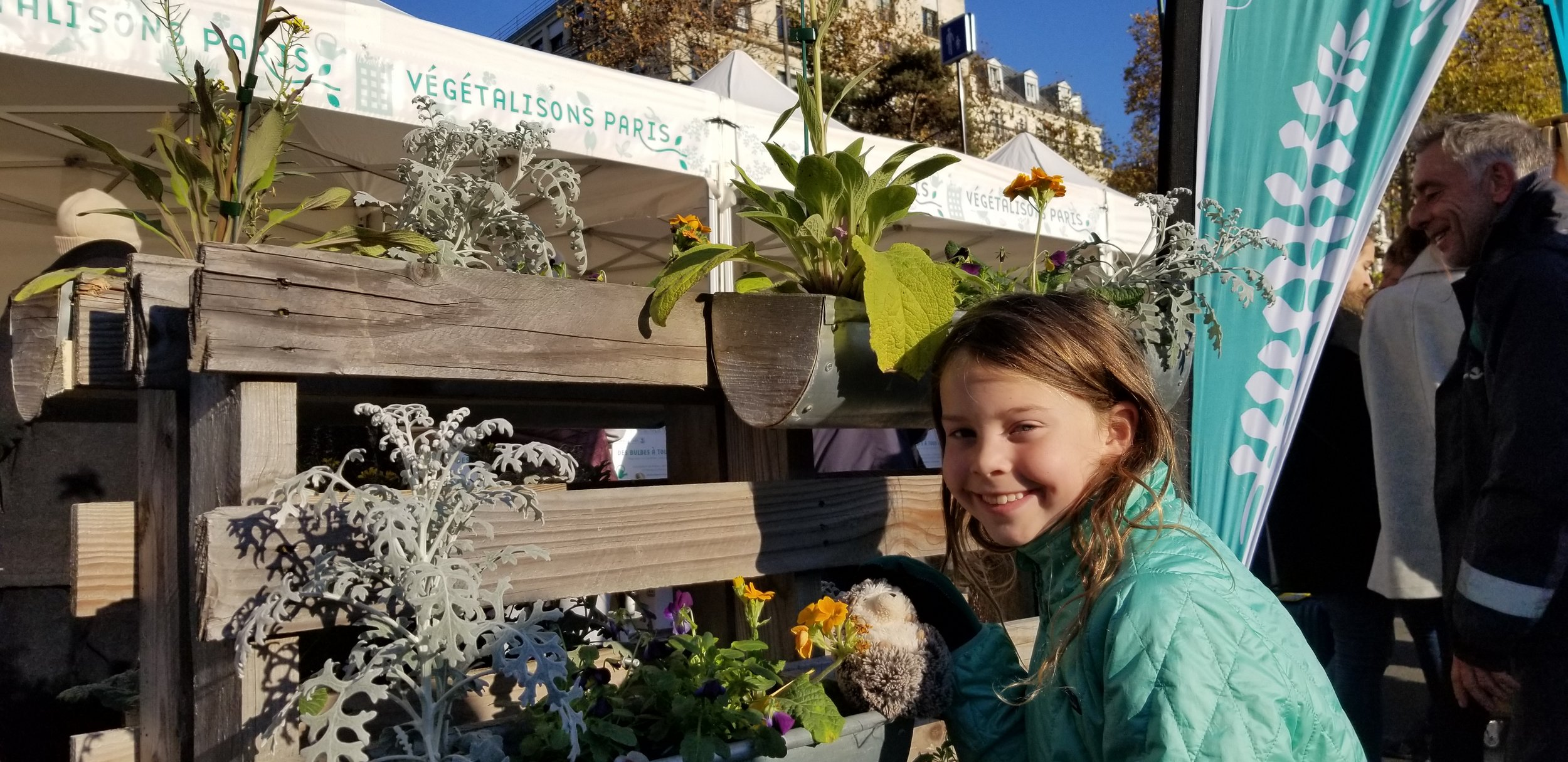 "How fun is this - they are giving away free plants, seeds and bulbs to anyone who stops by. This group ""Vegetalisons Paris"" wants everyone to have a few flowers and greenery in their lives."