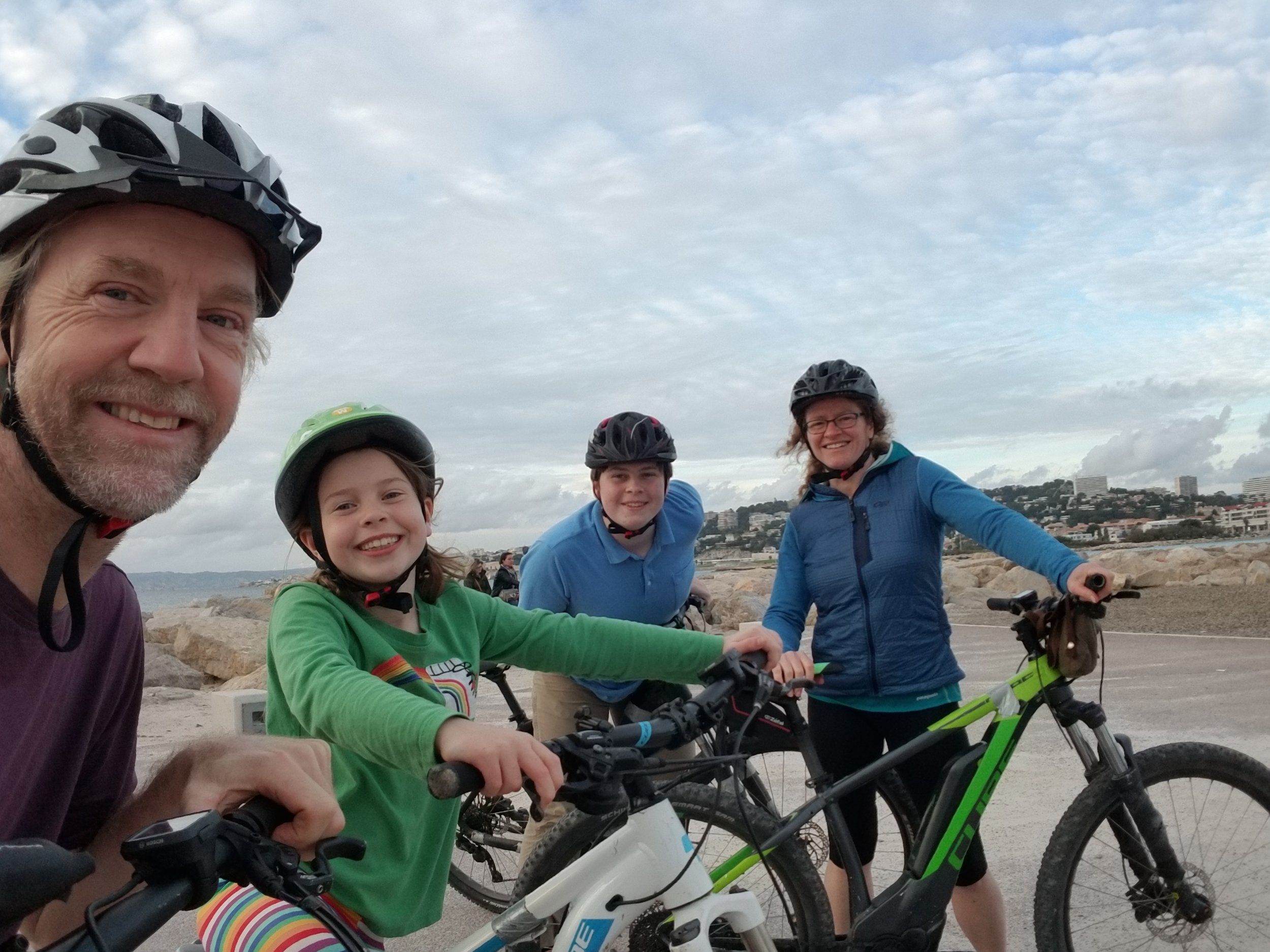 Back to sea level. (And almost back to the bike shop). Everyone still smiling except me. (they stuck me in a pannier - really?)