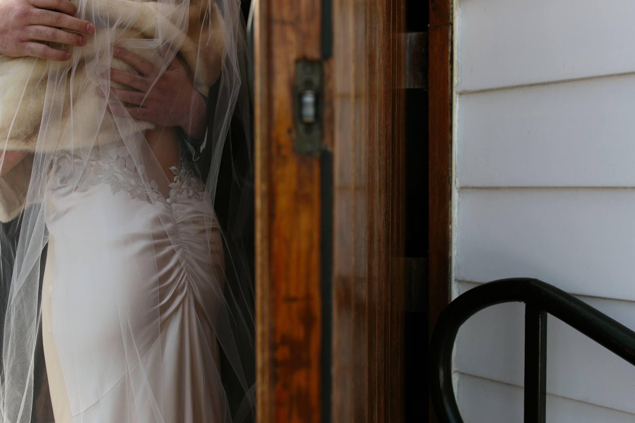 Embrace with a bride wearing a gorgeous blush toned Elizabeth Filmore dress