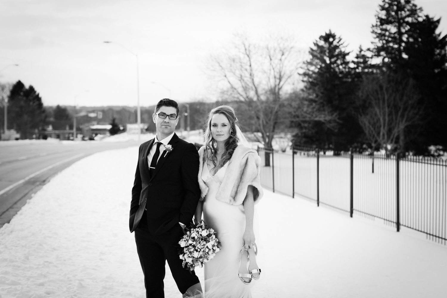 Stylish wedding couple in the snow