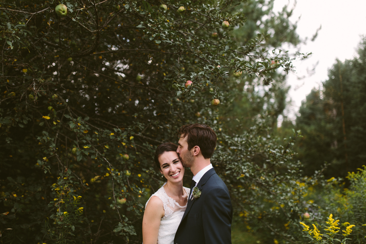 Couple kissing under an apple tree