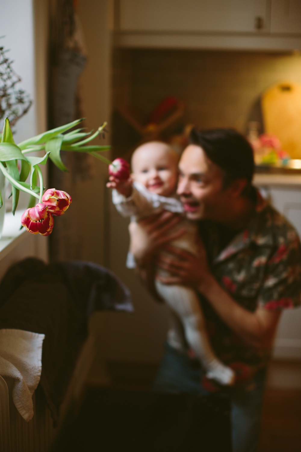 Father and daughter playing with tulips