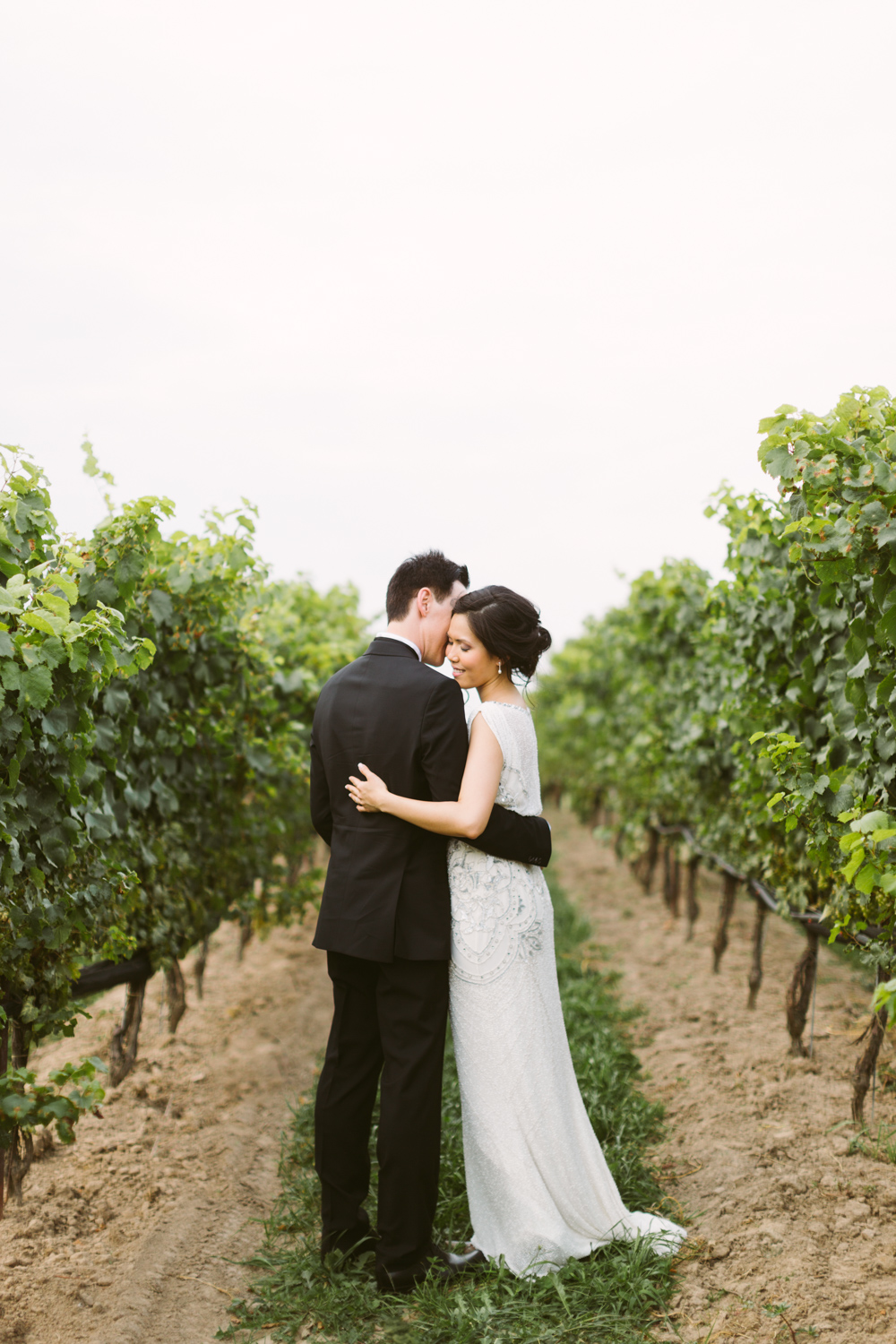 Romantic couple embracing in a vineyard
