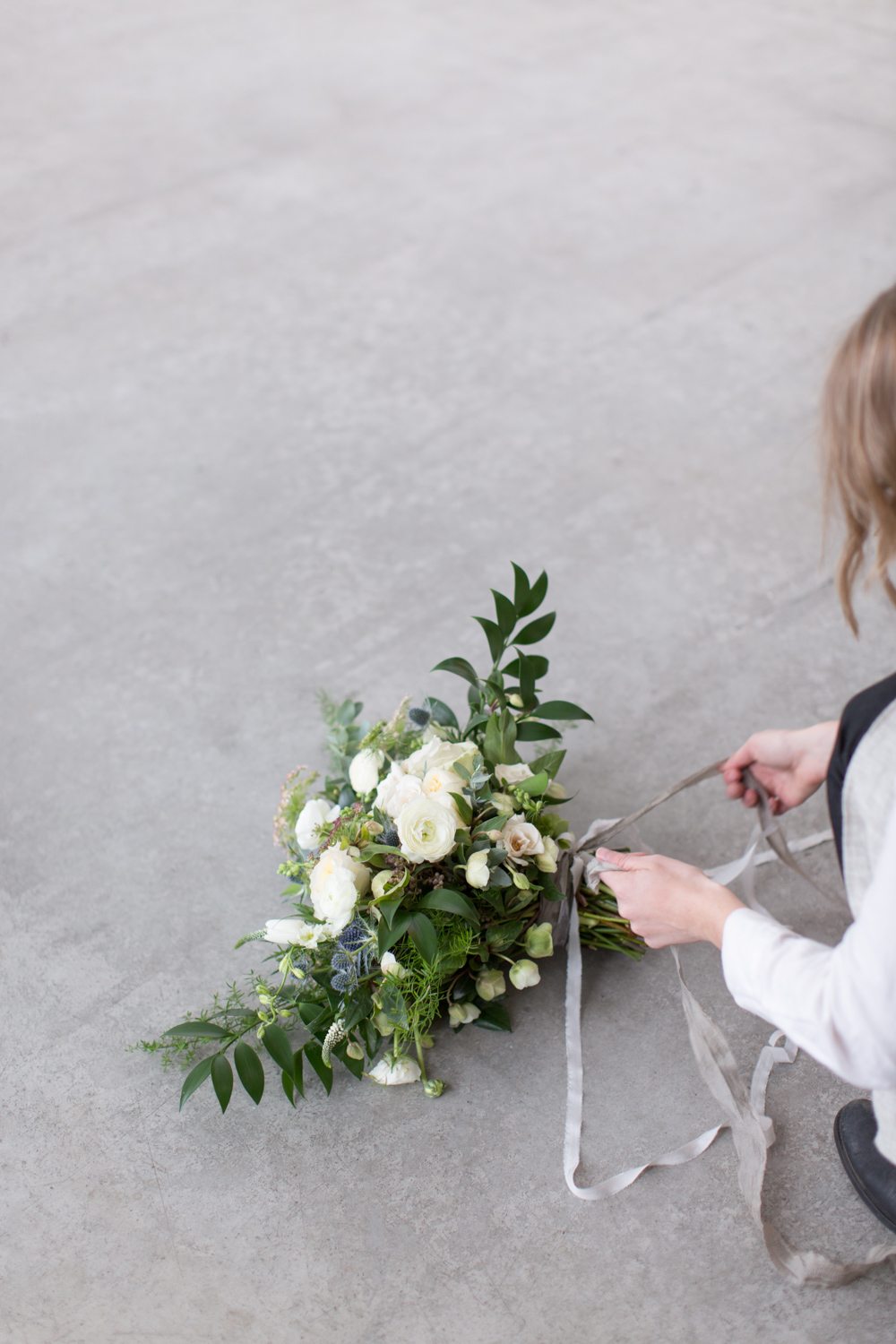 Florist tying an organic bouquet