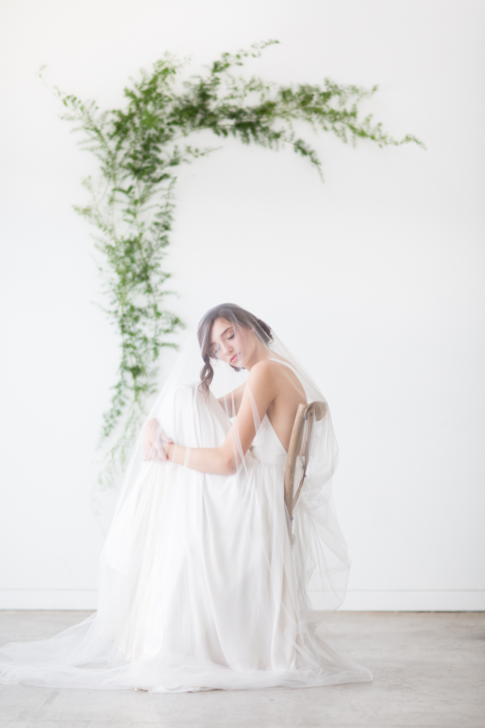 Minimal and timeless portrait of a bride wearing Brianna Truvelle dress