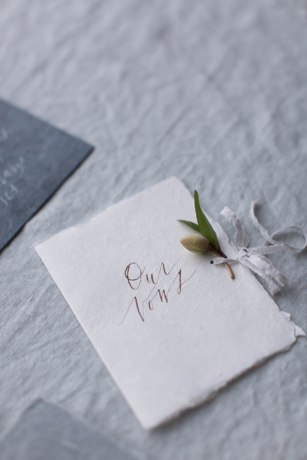 Vow booklet on handmade cotton paper and calligraphy by Paula Lee