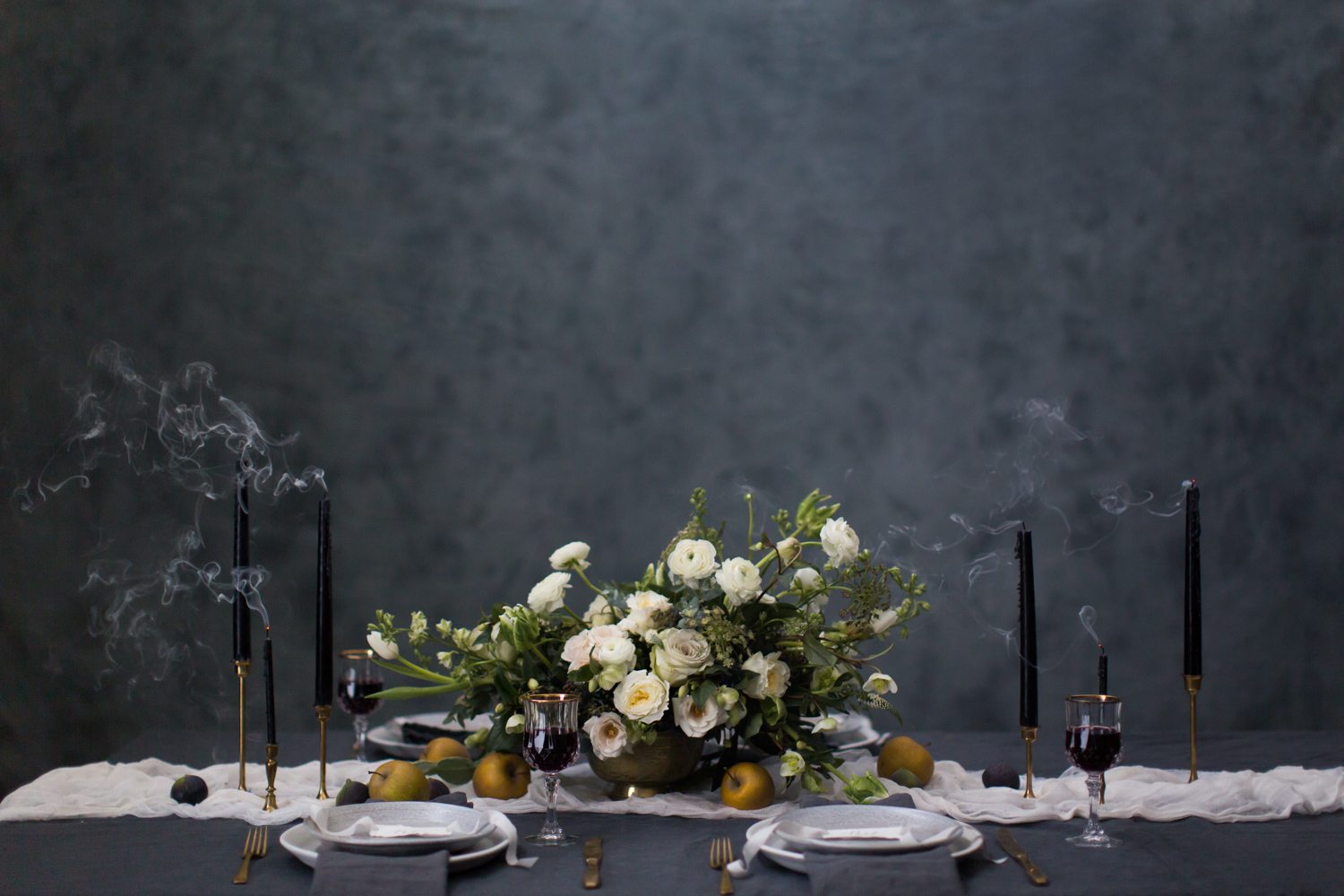 Tablescape with blownout candles and floral centrepiece by A Fine Medley