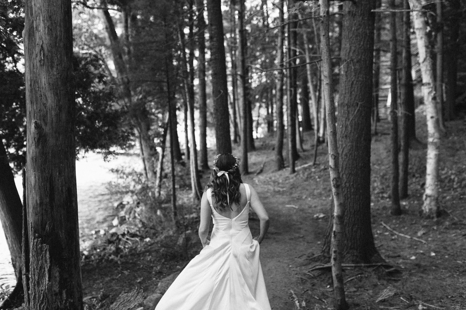 Bride running into a forest