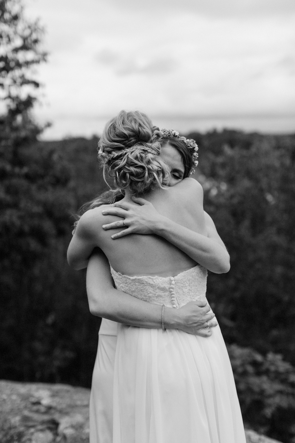 Two brides hugging