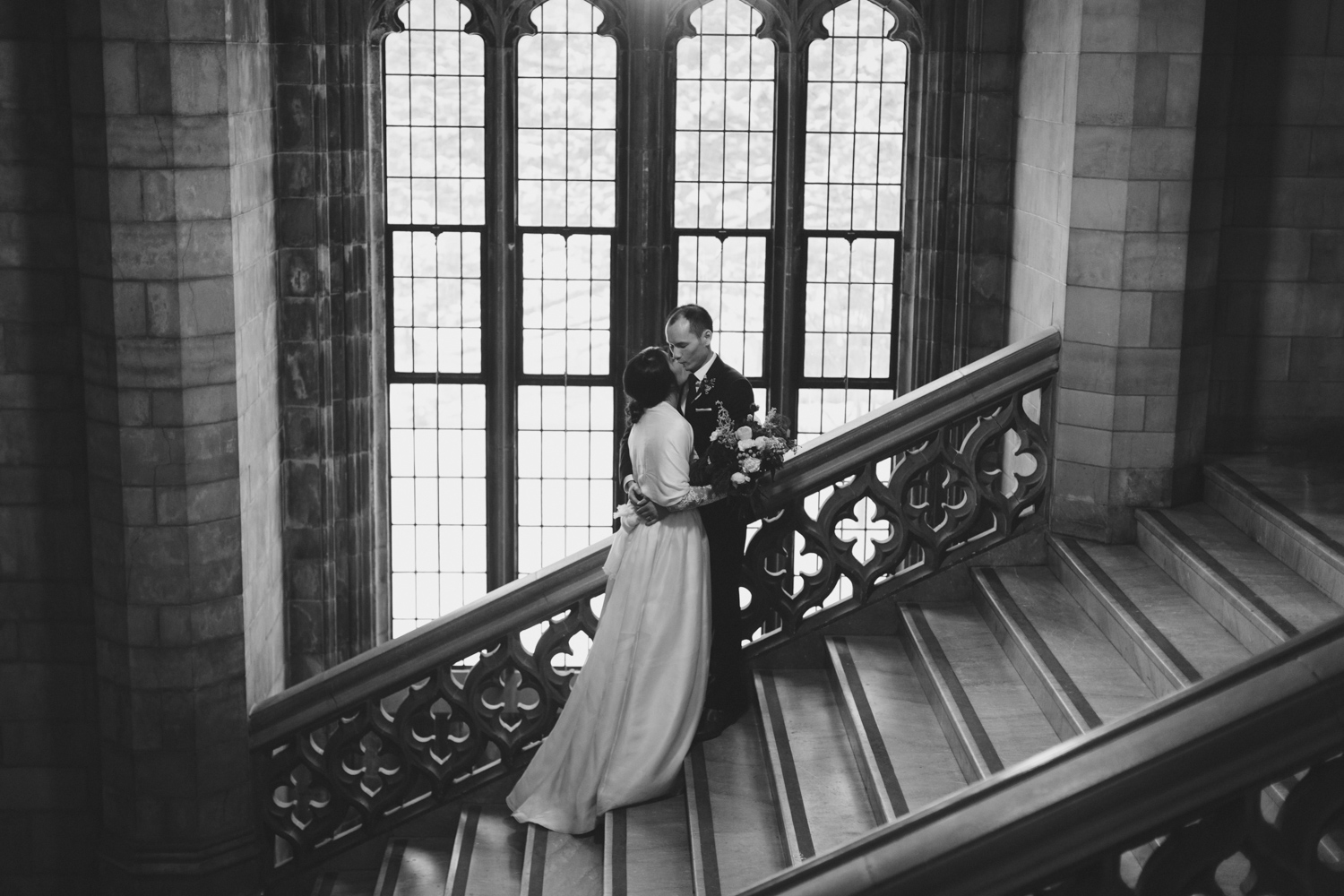 Couple kissing on the staircase of Knox Chapel at U of T