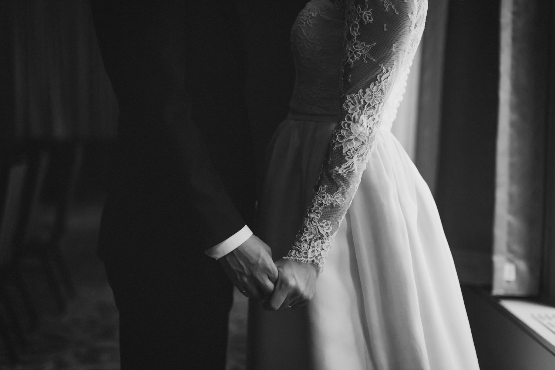 Bride holding her groom's hand