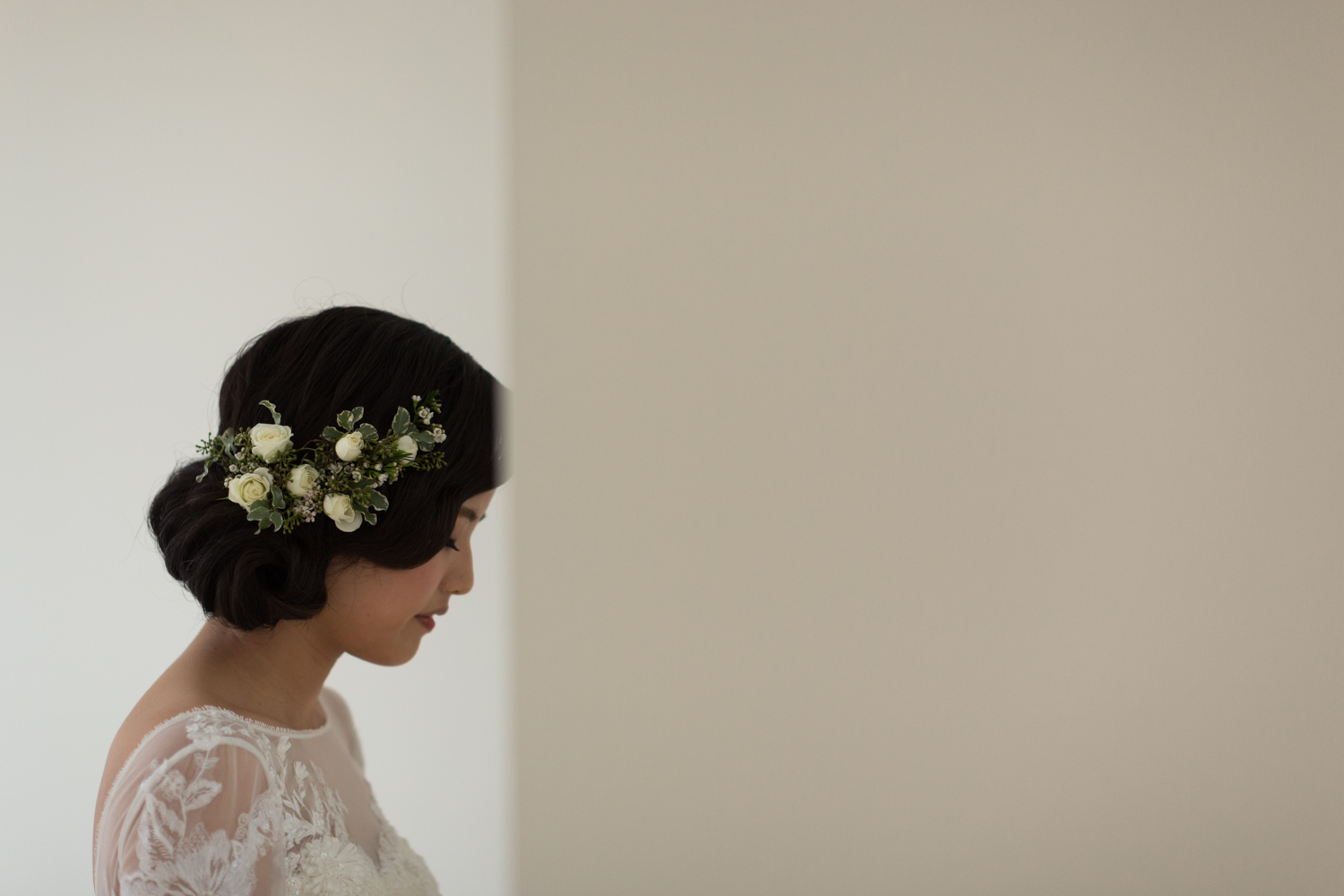 Bride with flowers in her hair getting eady