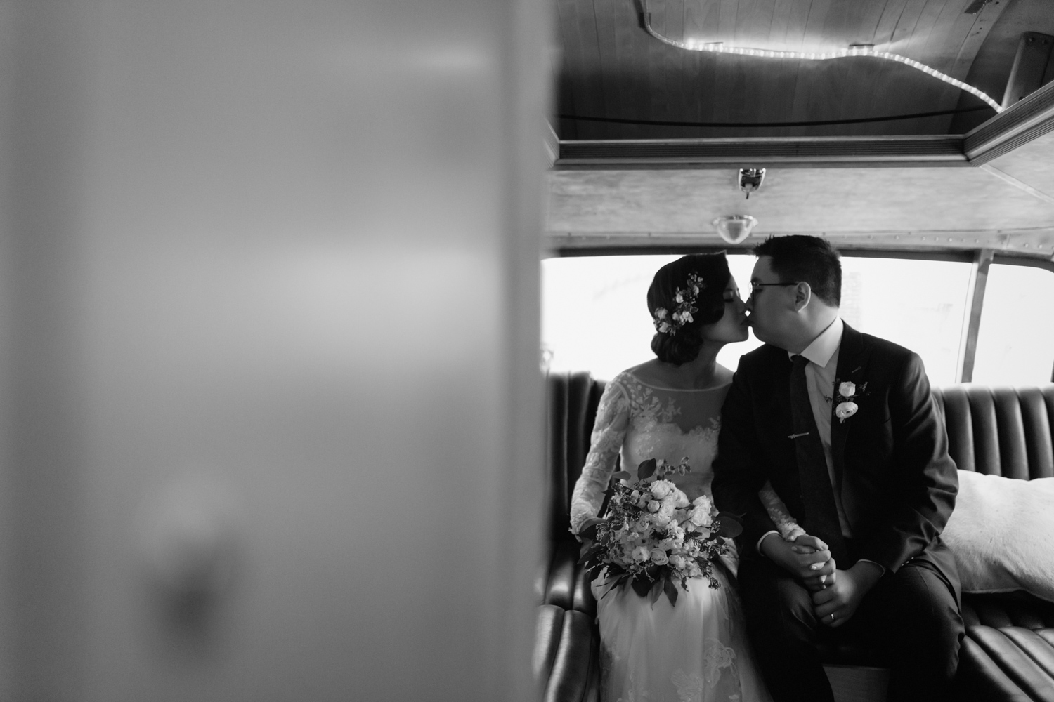 Romantic black and white image of couple in an airstream at Airship37