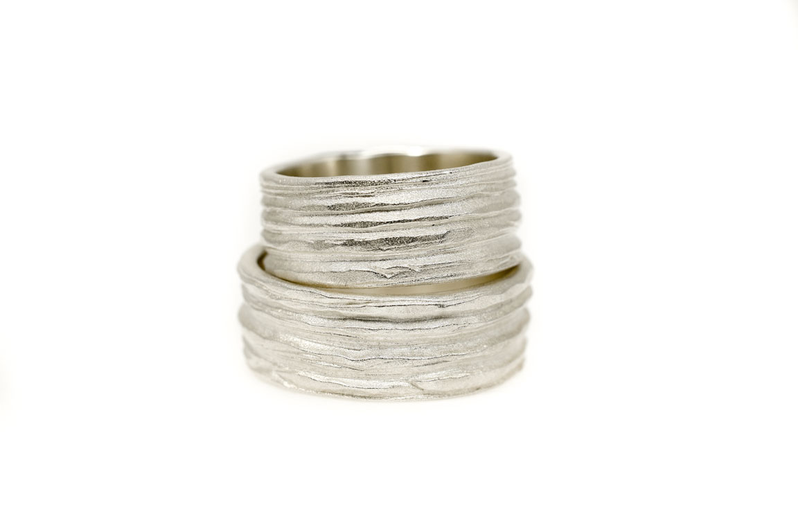 Symbiosis silver wedding rings