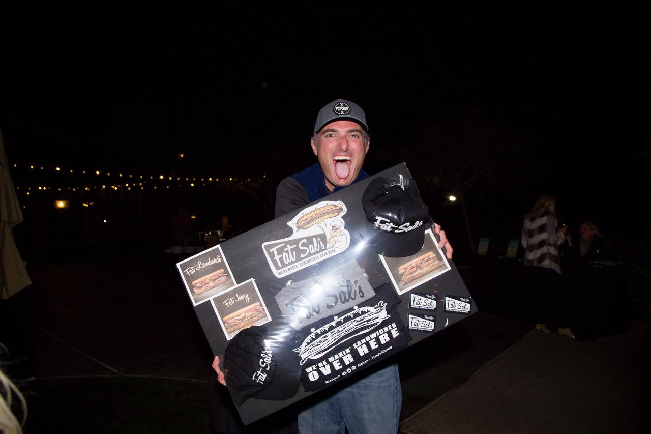 happy guy holding prize.jpeg