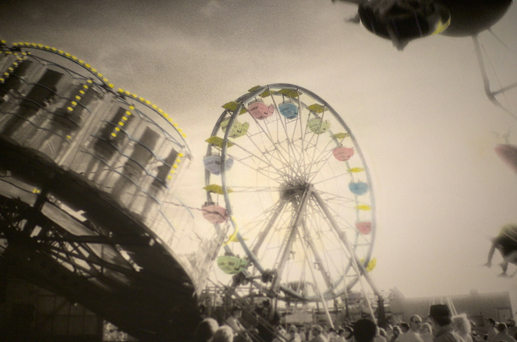 MIDWAY RIDES  , from  The Midway  series.  Hand-tinted silver gelatin print, infrared.  Limited Edition 3/10