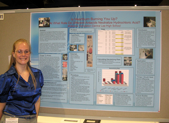 McKenna with her poster at the AmJAS/AAAS Annual Meeting