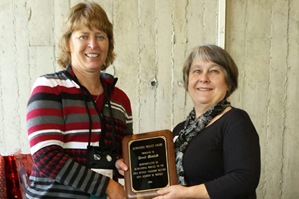 Traci Maxted (R), Cedar Rapids Jefferson High School receives an Outstanding Service Award from Nadine Weirather, President of the Iowa Academy of Science