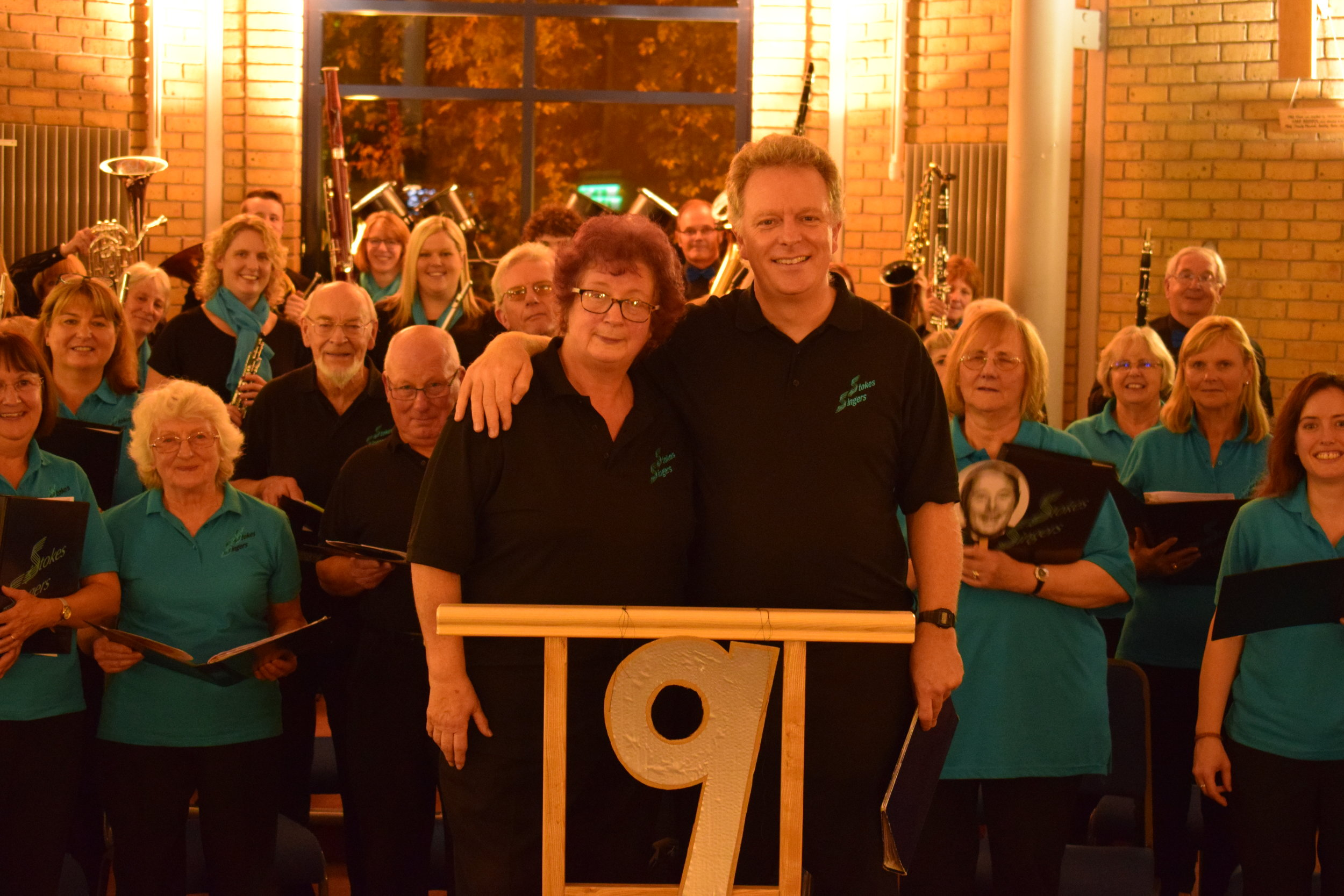 Event 9: Our 'Voices for Hospices' concert at Holy Trinity School, Bradley Stoke when we were joined by Apollo Wind Band to raise funds for St Peter's, Bristol's adult hospice.