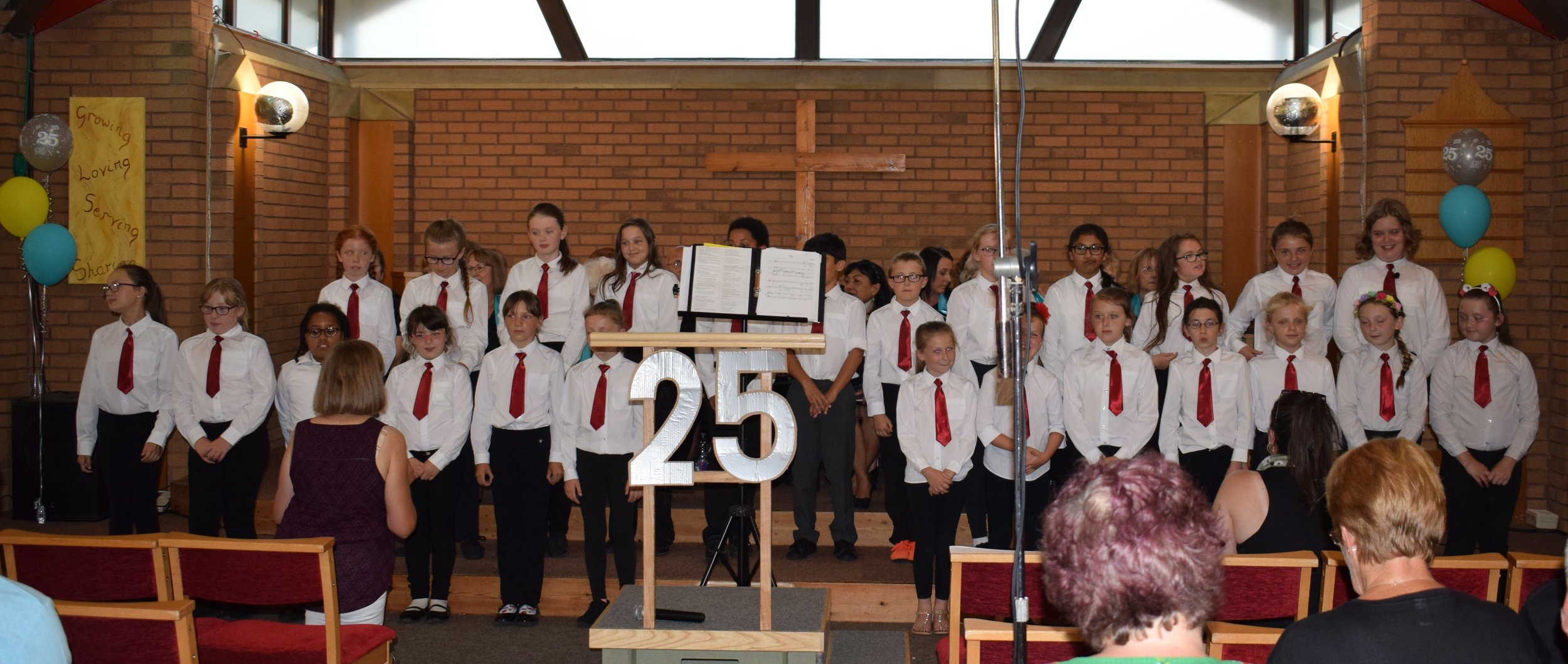 The Red Tie Choir led by Anne Sargent and Rosie Griffiths