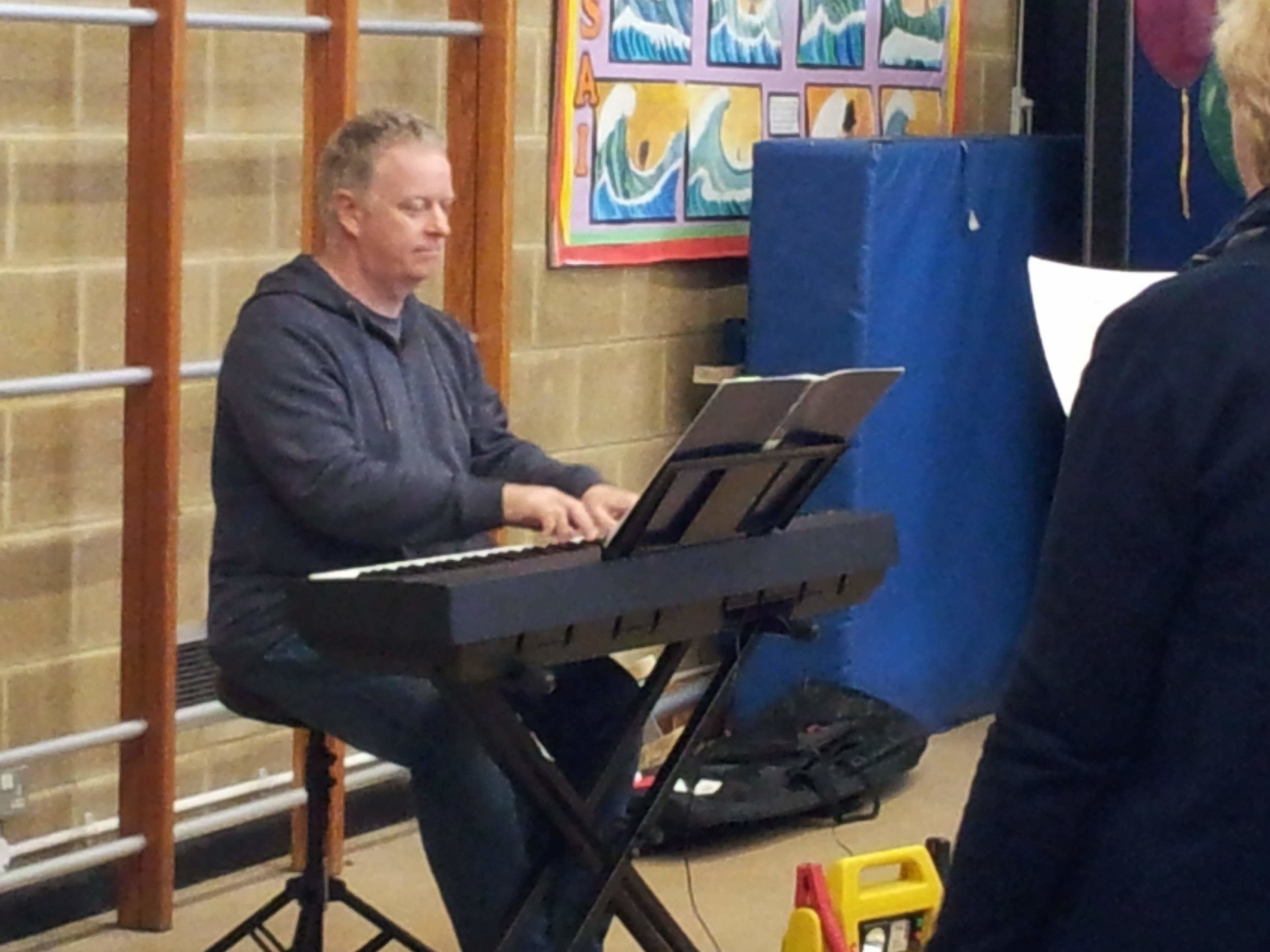 Phil Lawrence, our Joint Musical Director, on keyboard whilst we sing his arrangement of Stand By Me.