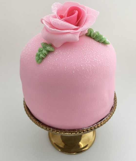 Whether it's white almond, dark chocolate, or a princess cake, Kris Torres makes it happen.