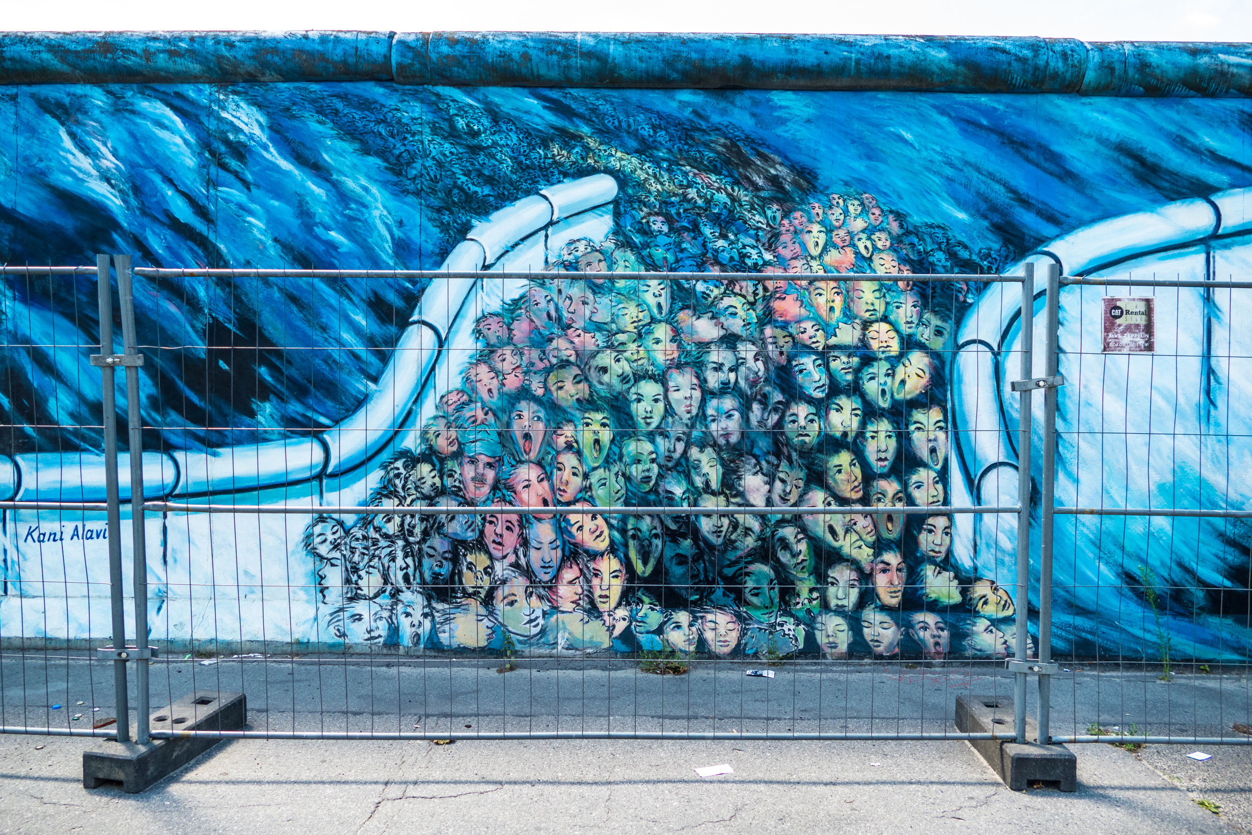 East Side Gallery picture of escape through the Berlin Wall (but trapped behind the barriers).