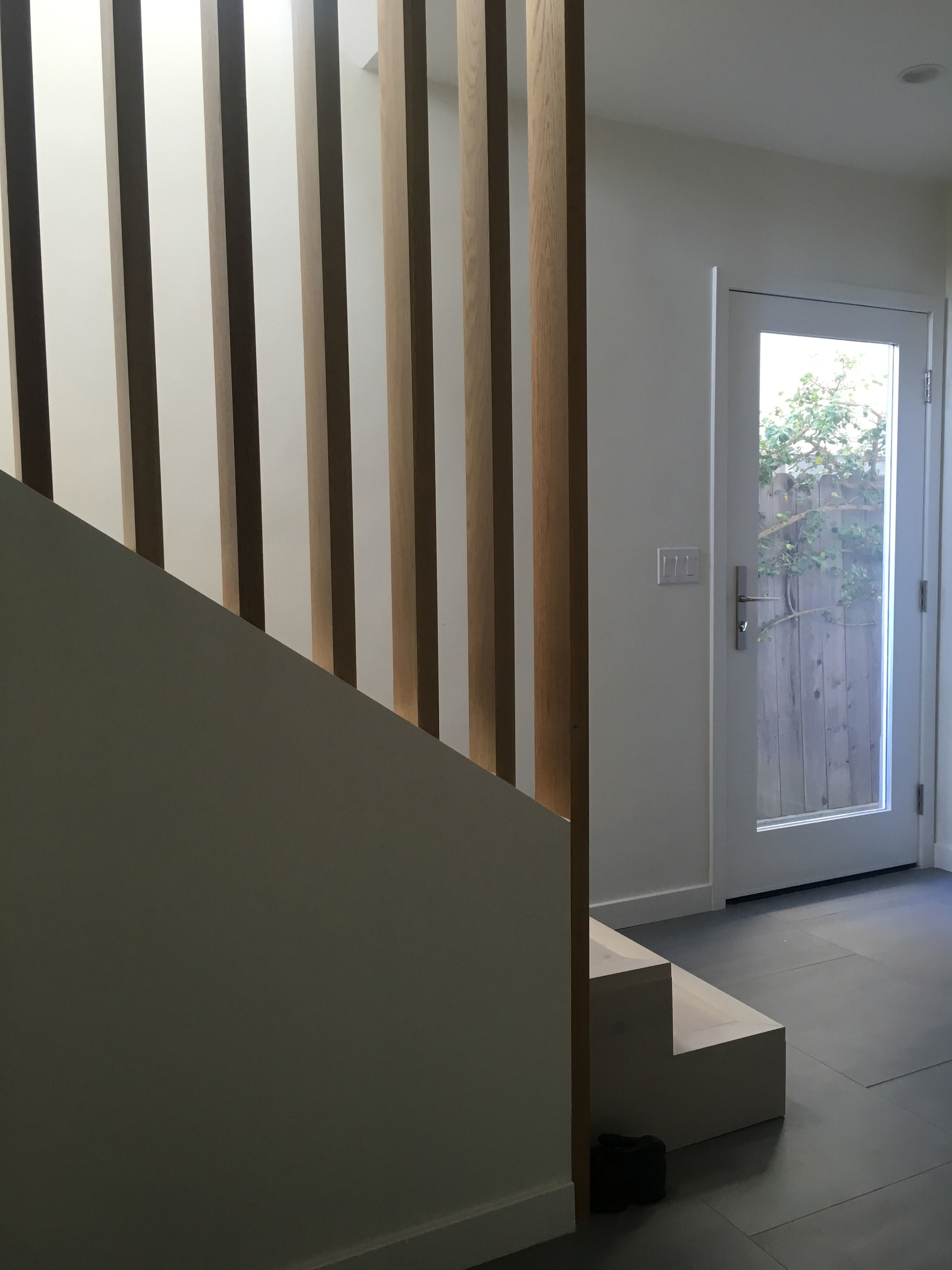 A superfluous staircase post was removed and ceilings were raised to 10 ft. to create a more spacious and comfortable entry.