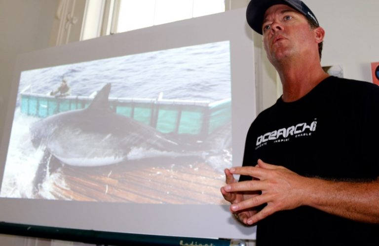 Chris Fischer, TV fishing show host and founder of Ocearch, tells a standing-room-only crowd at the Sag Harbor Whaling Museum on Saturday, August 27, about the organization's effort to tag great white sharks and collect data to prove that they breed in the waters just off Long Island's beaches. Peter Boody photo