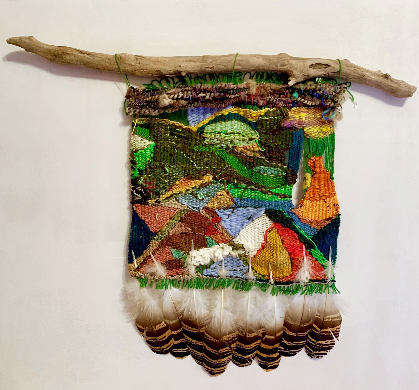 "Candace Hill Montgomery (American, born 1945), ""I Had to Assure the Falcon its Wings would be Kept together as a Family,"" 2018. Sheep roving, bouclé, linen, wool, silk, falcon feathers. Driftwood (hanger), 28 x 14 inches."