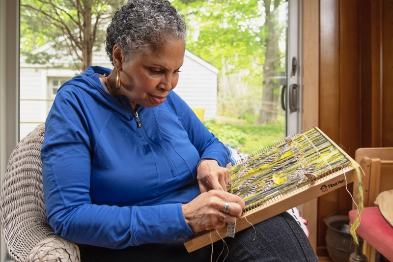 Candace Hill Montgomery at work weaving in her Bridgehampton home. Michael Heller photo