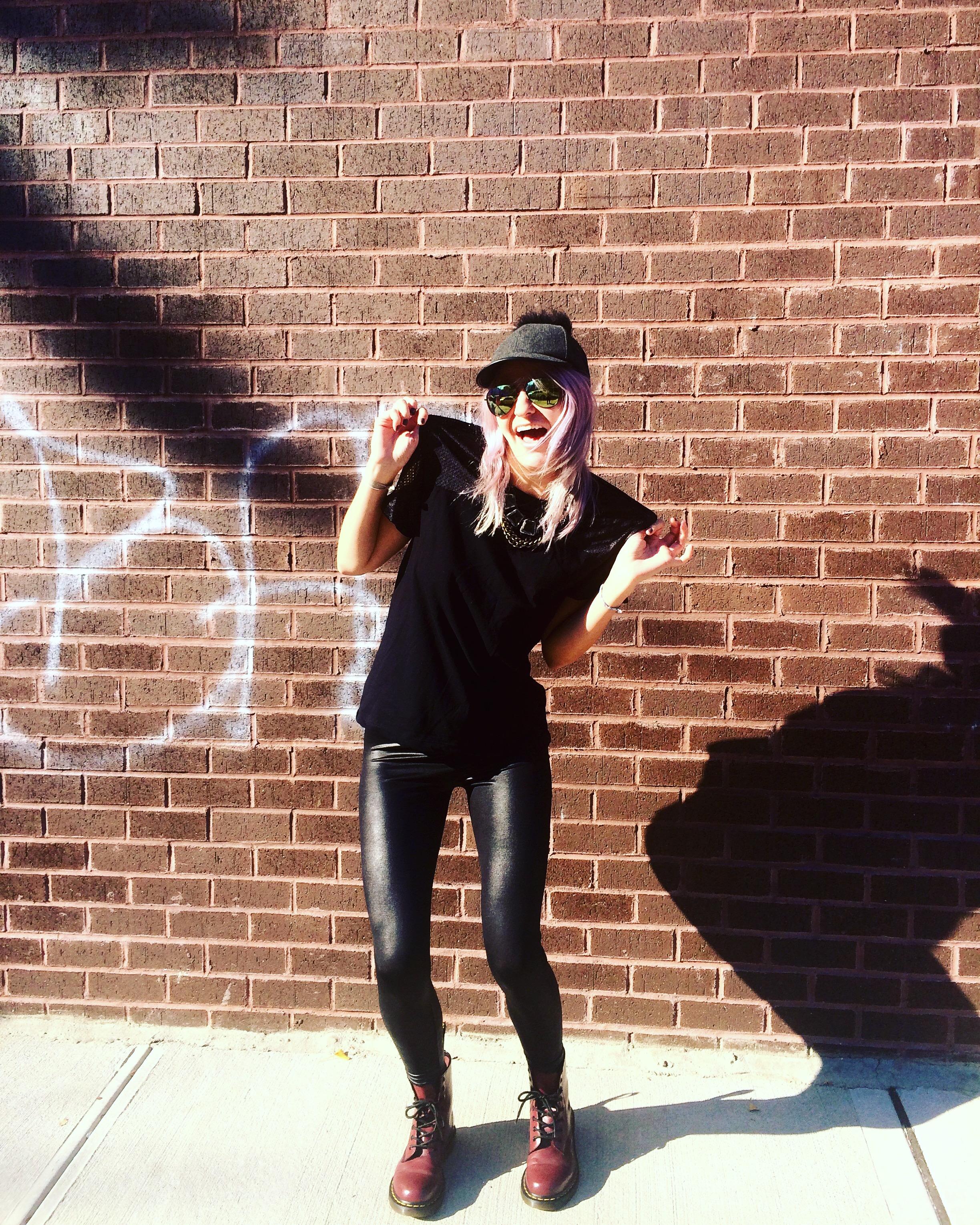 Cap: BCBG, Sunglasses: Nordstrom, Necklace: J.Crew, Mesh Black Tee: American Apparel, Pleather Leggings: HUE, Boots: Doc Marten  Location: Bushwick, Brooklyn;Photos by: Victoria Kass