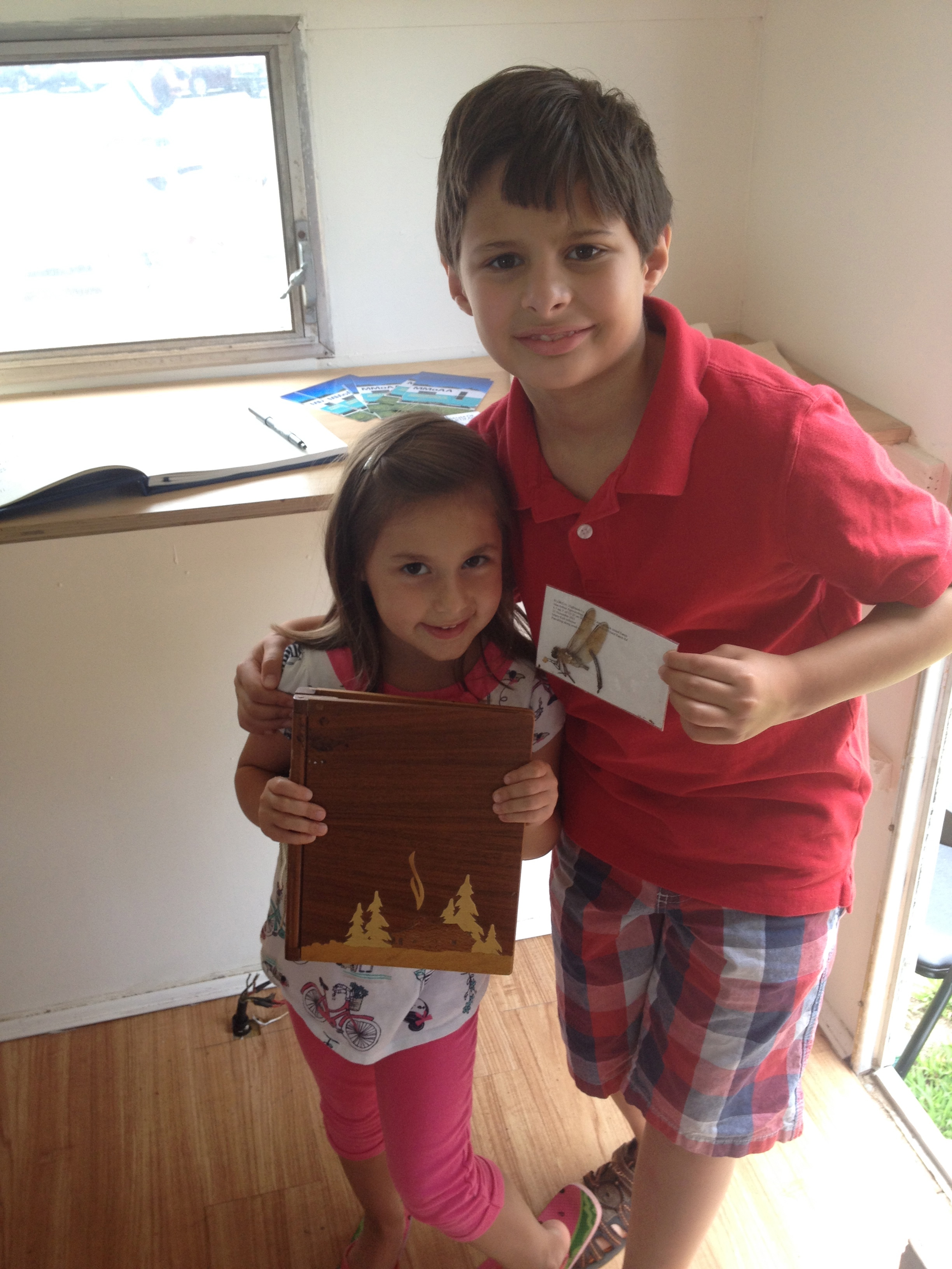 Siblings choose their favorite artifacts inside MMoAA at the Edgewood Park Farmer's Market.