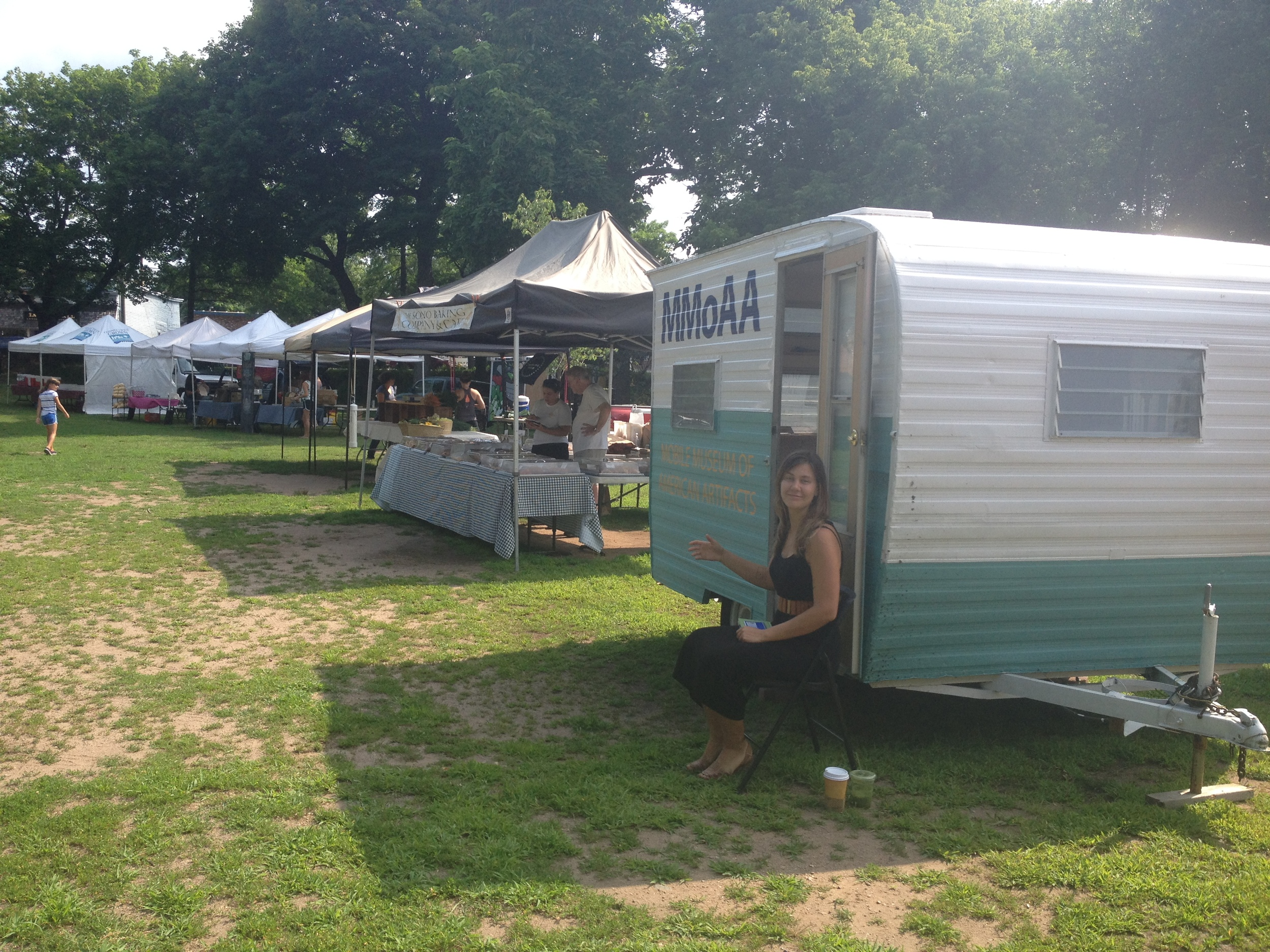 Laurelin sets up for the Edgewood Park Farmer's Market on July 14, 2014.