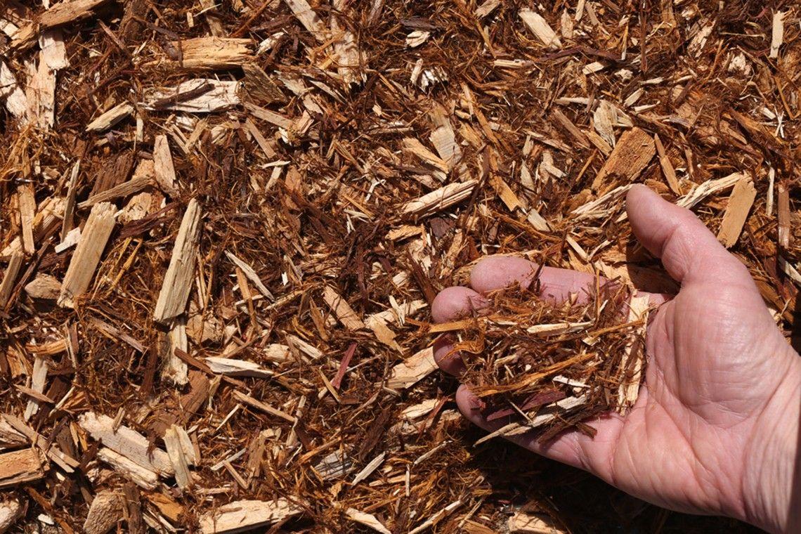 white-cedar-mulch-hand-compressor.jpg