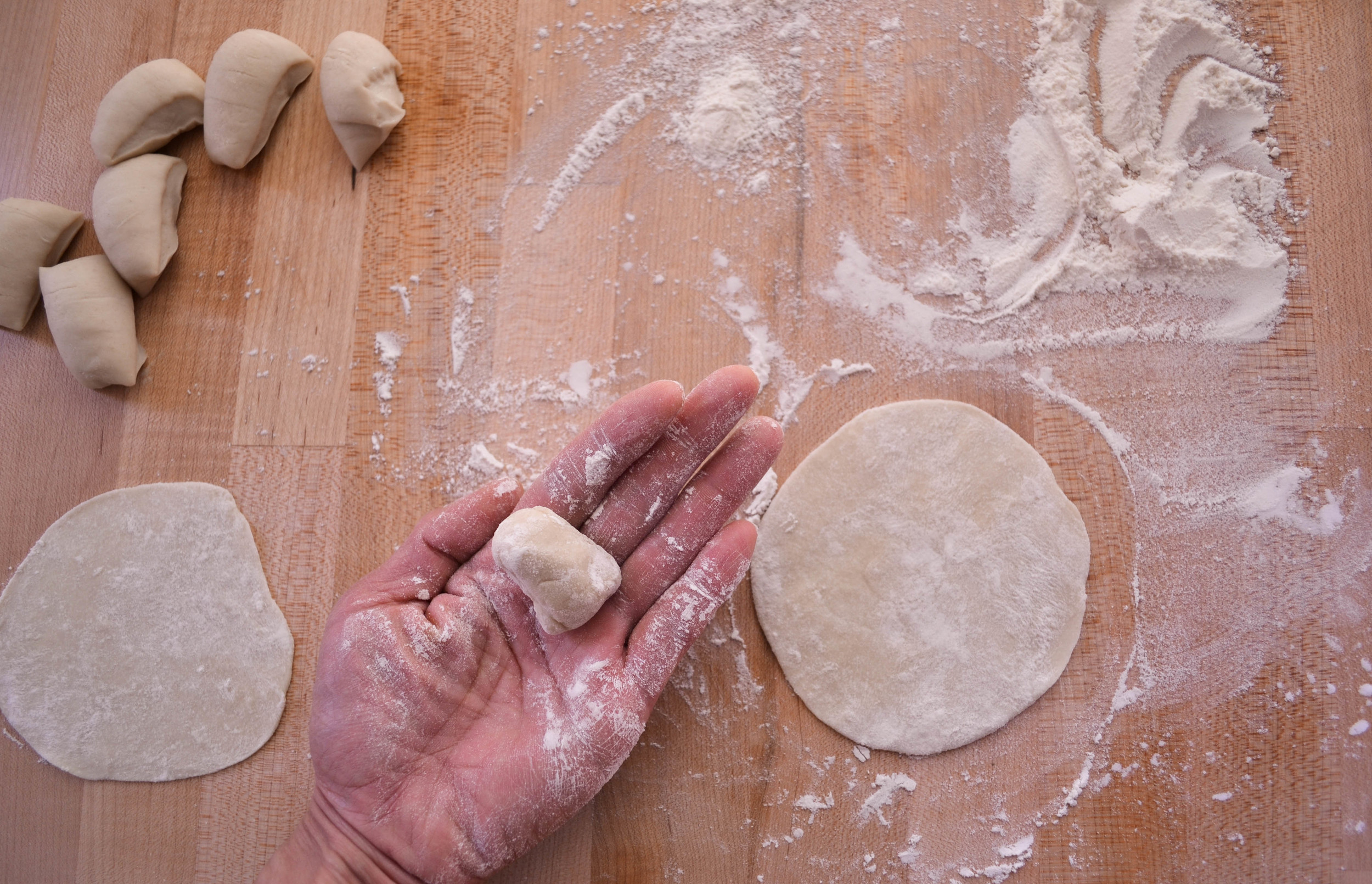 Chinese hands, rolling out dough.