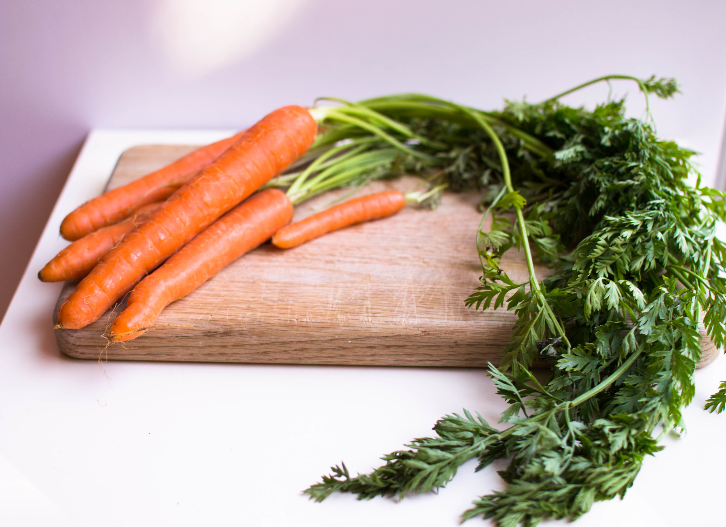 Gorgeous carrots and their tops. Use it all!
