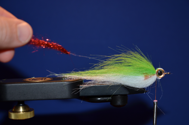 Tie in about a 5-6 inch piece of 20lb mono with flash tie to the end.