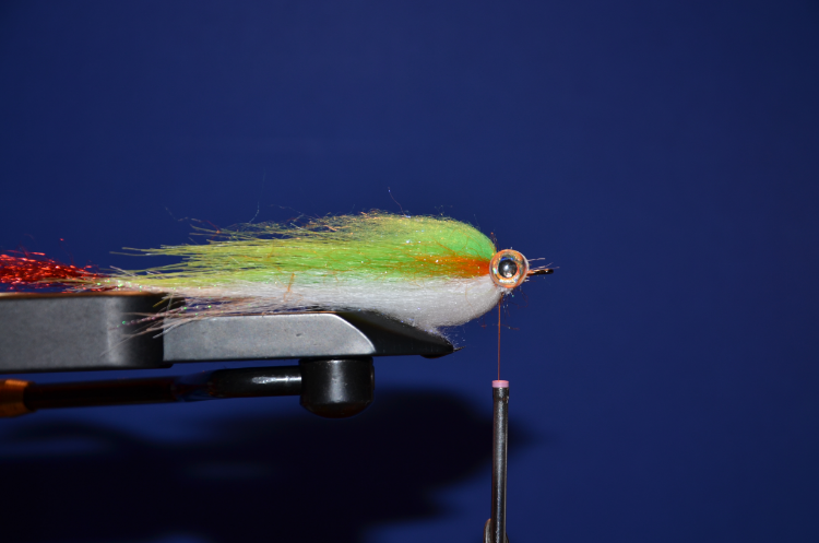 Add a small amount of different color dubbing on each side of the eye. I like using orange, pink, and red depending on the main color of the fly.