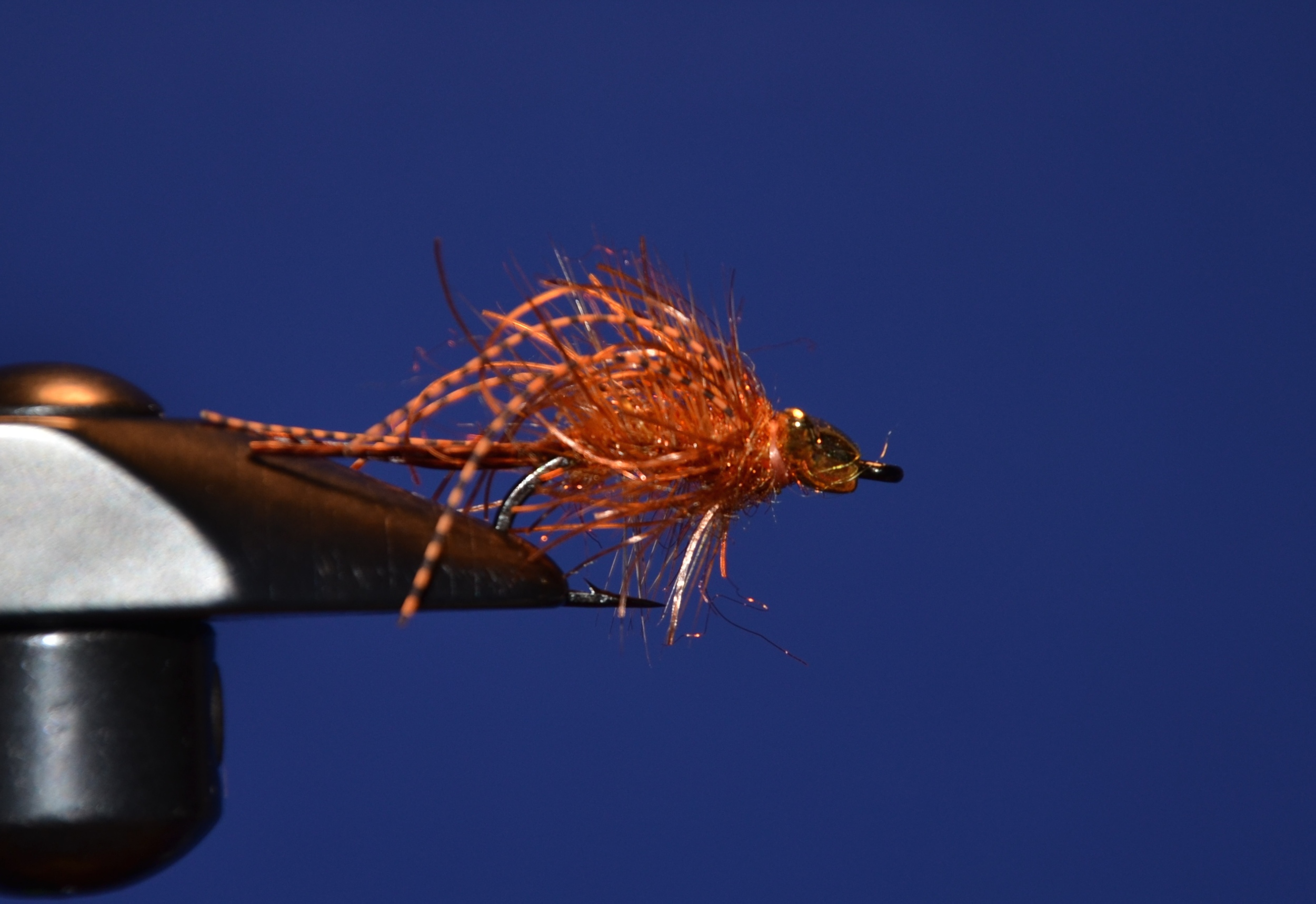 Add another few turns of Carp Dub and whip finish and trim. Make sure the widest part of the bead is facing up. It allows the fly to ride hook point up, which is ideal for the rubber lips.