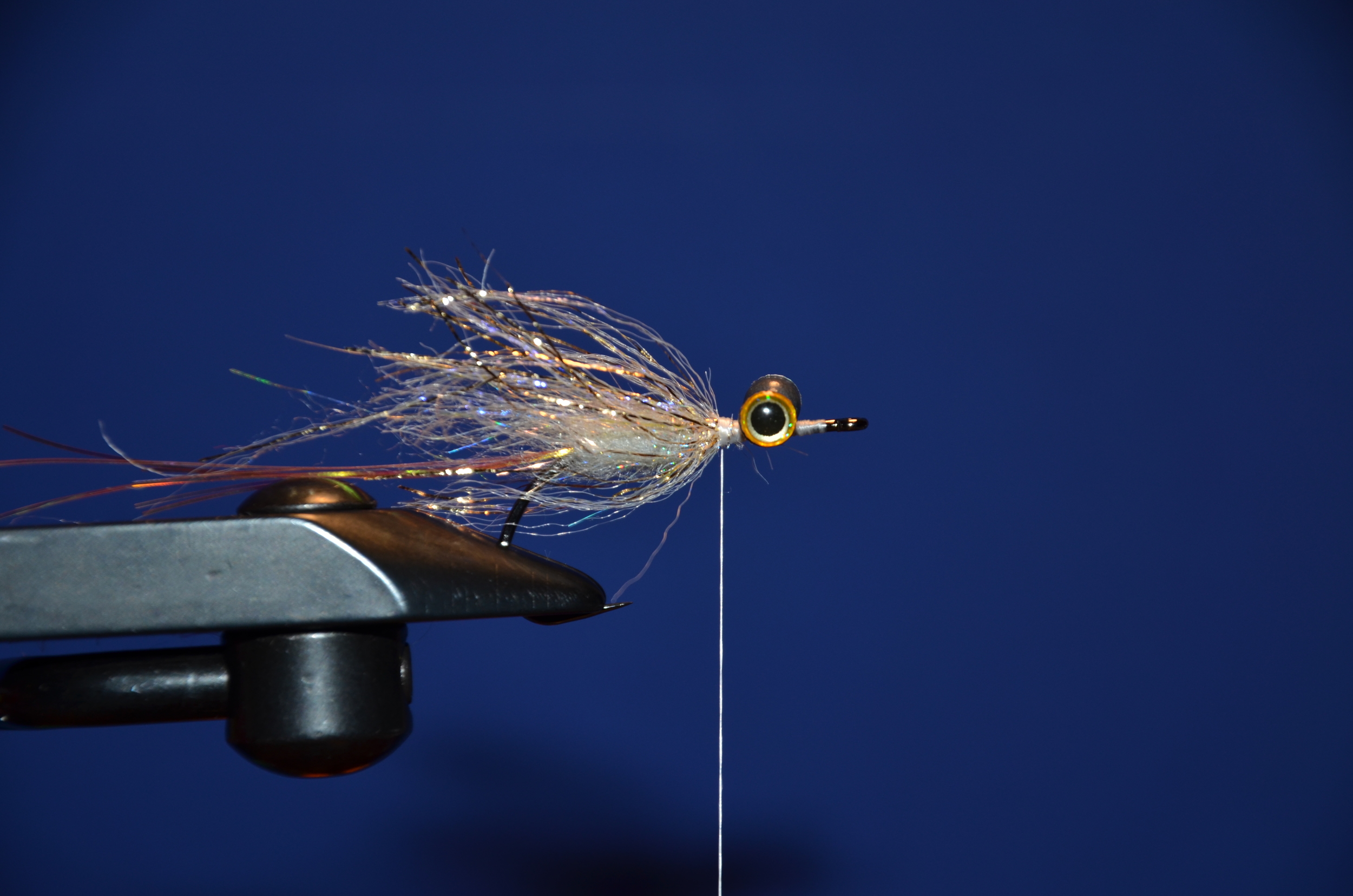 Tie Gold uv polar flash and give it 2-3 turns, make sure to brush the fibers back as you wrap.
