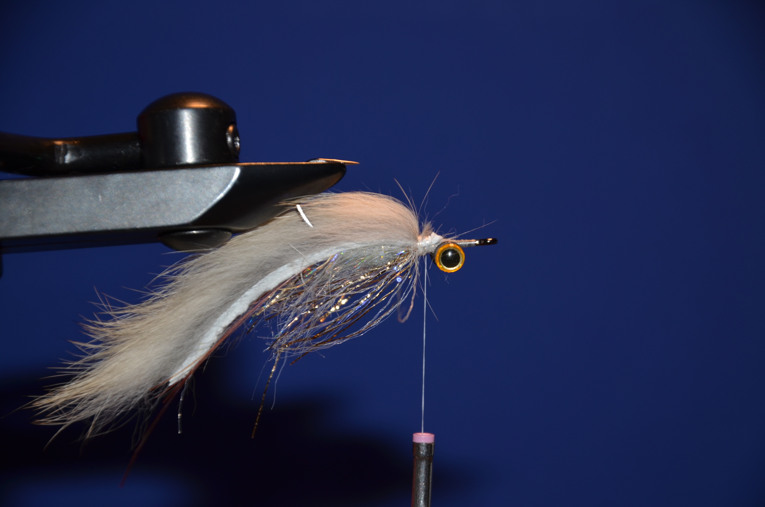 Add tan/flesh zonker strip, i meausre a hook shank and poke it though and tie it down