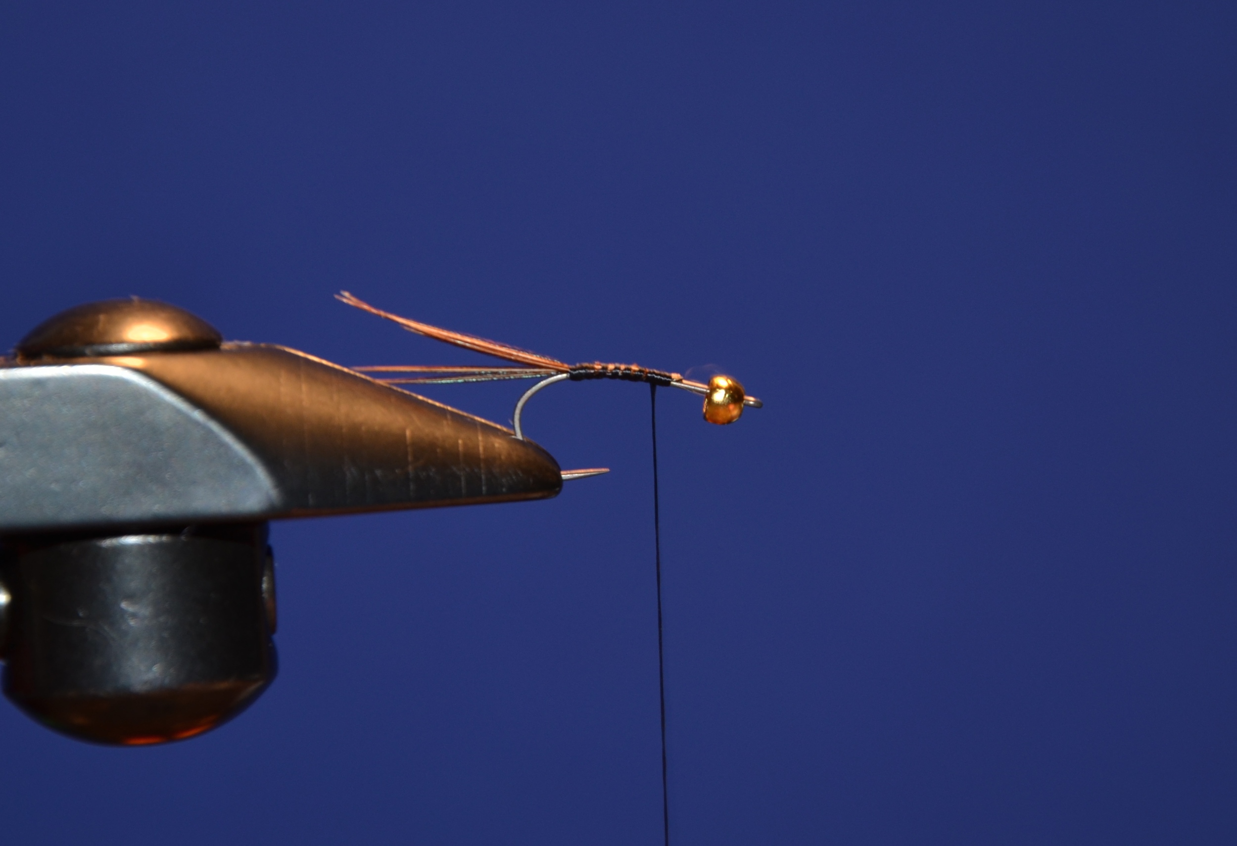 Attach thread and tie in 5-6 pheasant tails.