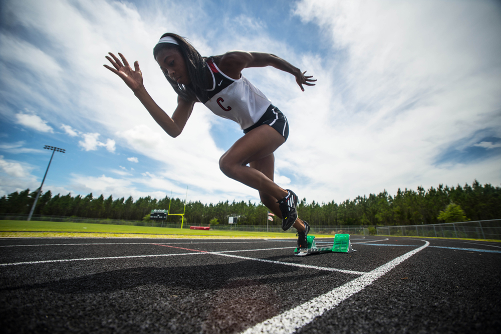 Jordan Fields, sophomore for Creekside High School, takes off during a photoshoot.