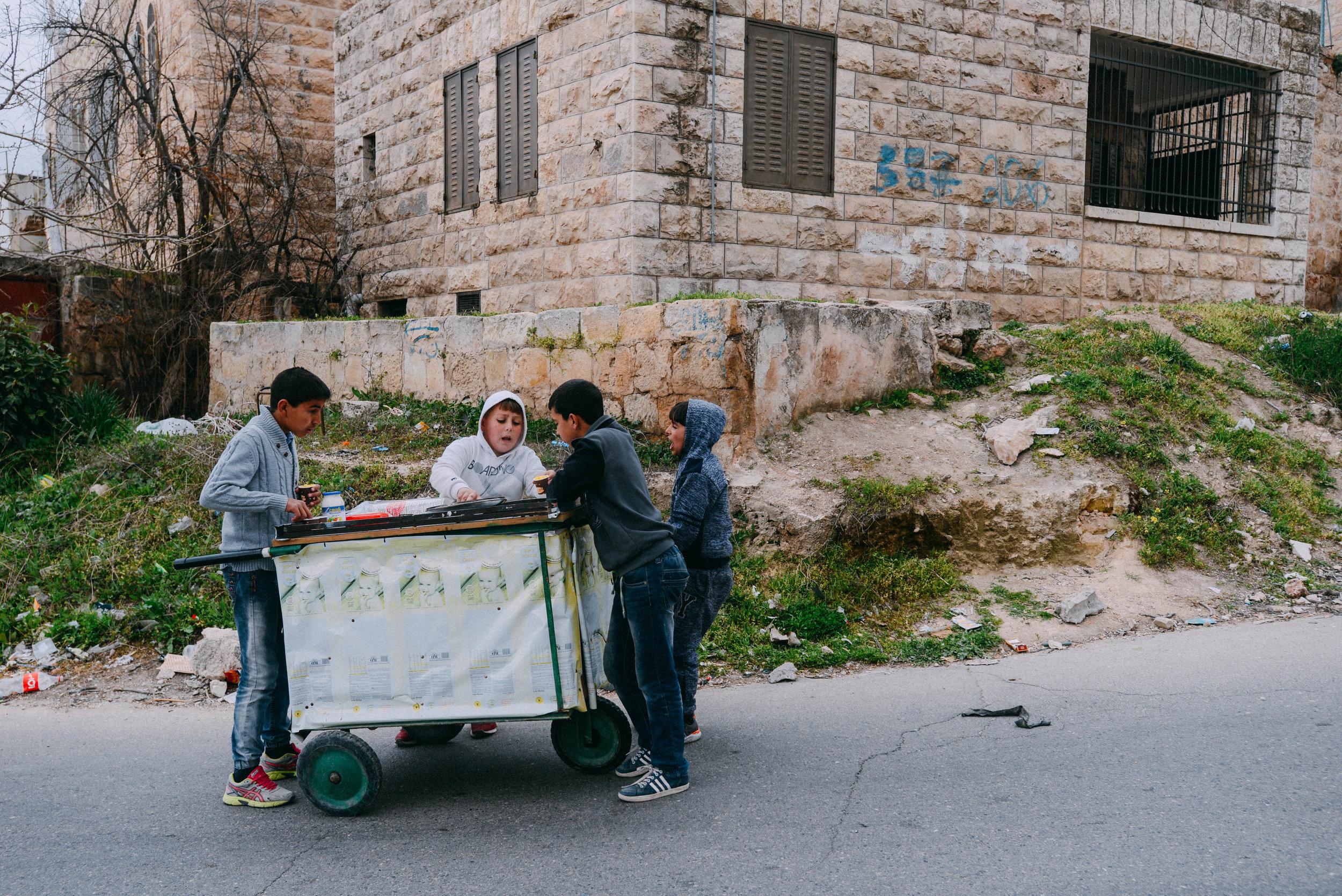 Boys selling food in Hebron, Palestine.