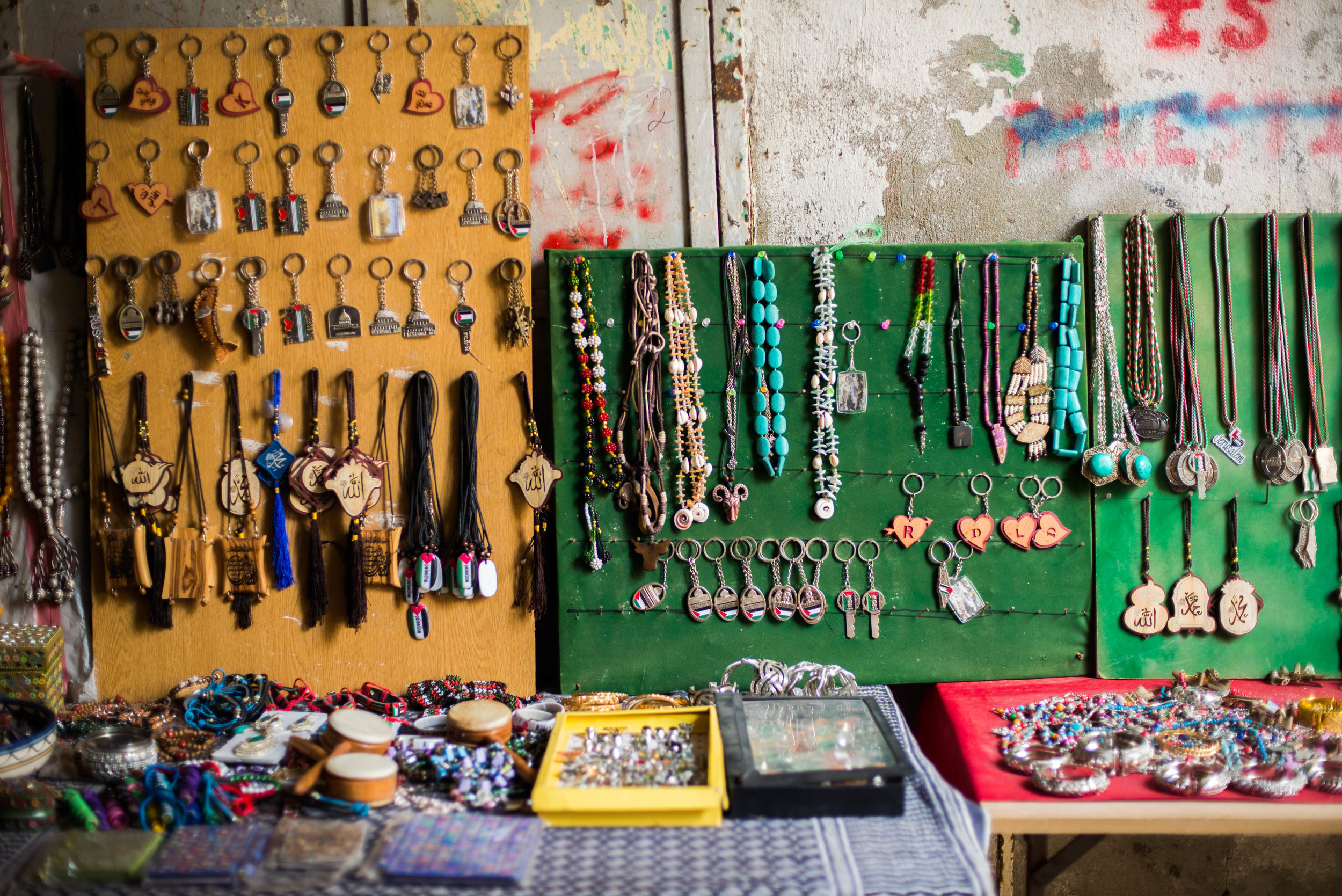 Some of the crafts made by the cooperative are set out on the table in the Old City of Hebron market in H1.